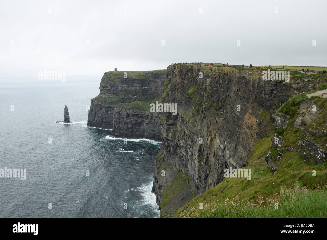 View of the Cliffs of Moher with O'Brien's Tower and Branaunmore sea stack in the County Clare, west Ireland - Stock Image