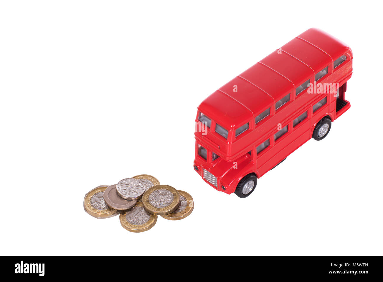 Red double-decker bus with a pile of loose sterling change in a concept of the costs of public transport in Britain isolated on white - Stock Image