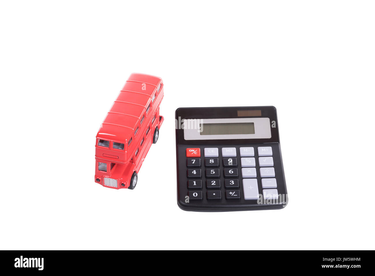 Red toy double-decker British bus and calculator in a concept of costs of commuting and public transport isolated on white - Stock Image
