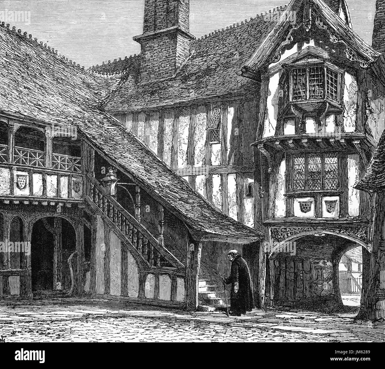 1870: The courtyard of Leicester's Hospital.  The Hospital is a historic group of timber-framed buildings in Warwick High Street dating mainly from the late 14th Century. In the reign of Queen Elizabeth I it became a place of retirement for old warriors known as the Brethren. The Brethren and Master, who still live within the walls of the building, are a living legacy of almost 450 years of history,  Warwickshire, England. - Stock Image