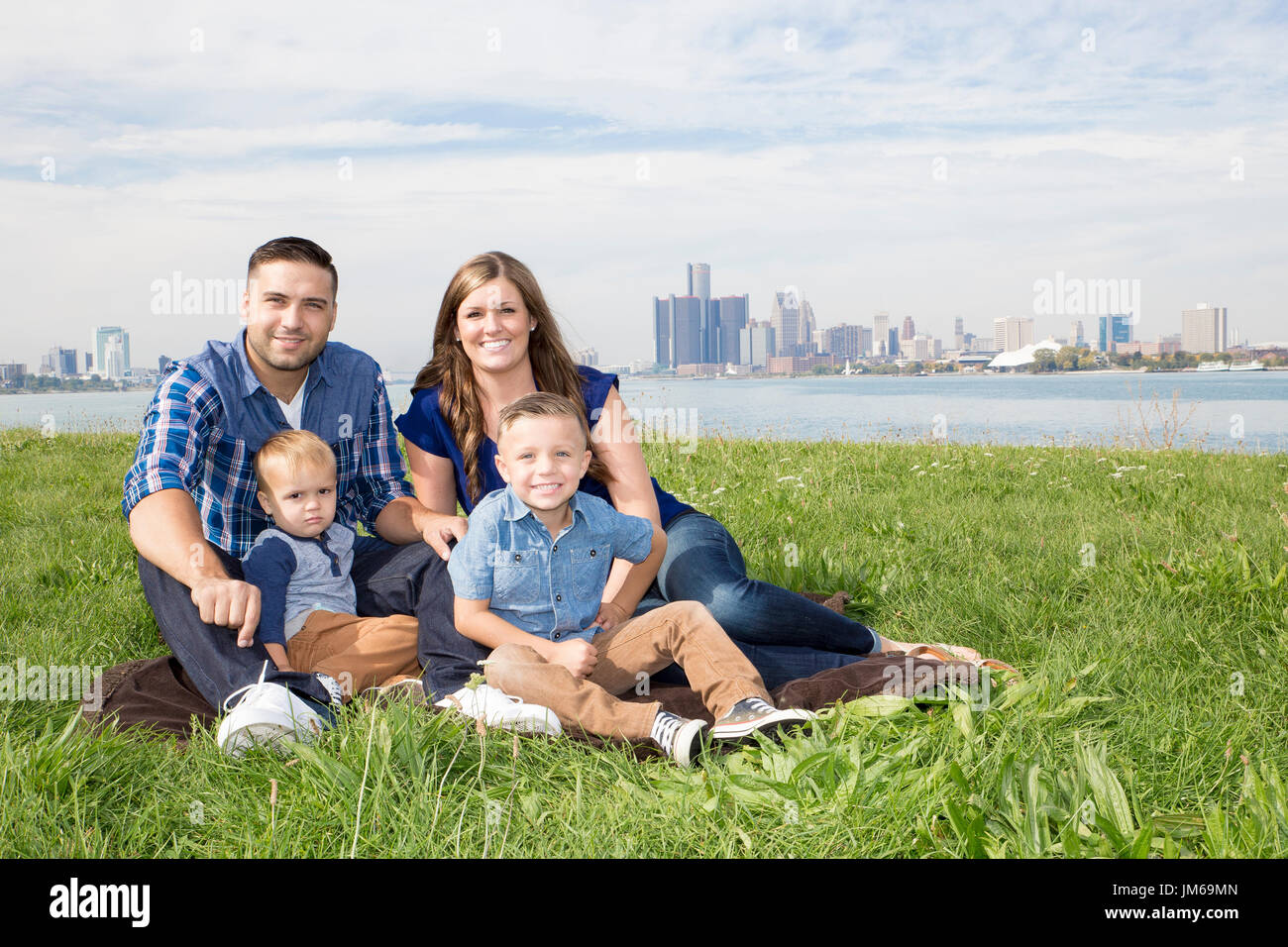 A family at the park in the city - Stock Image
