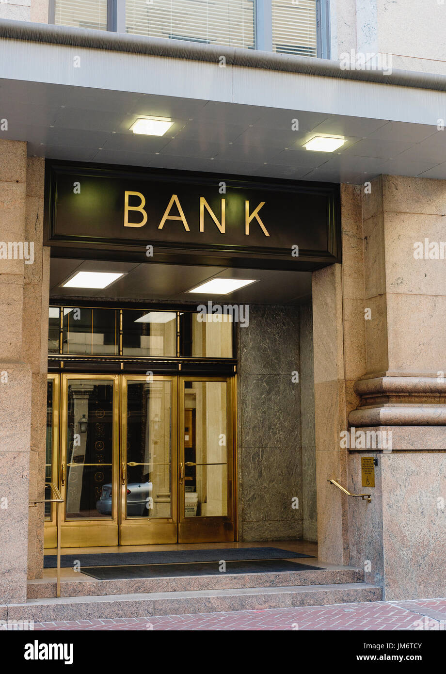 The entrance to a bank. - Stock Image