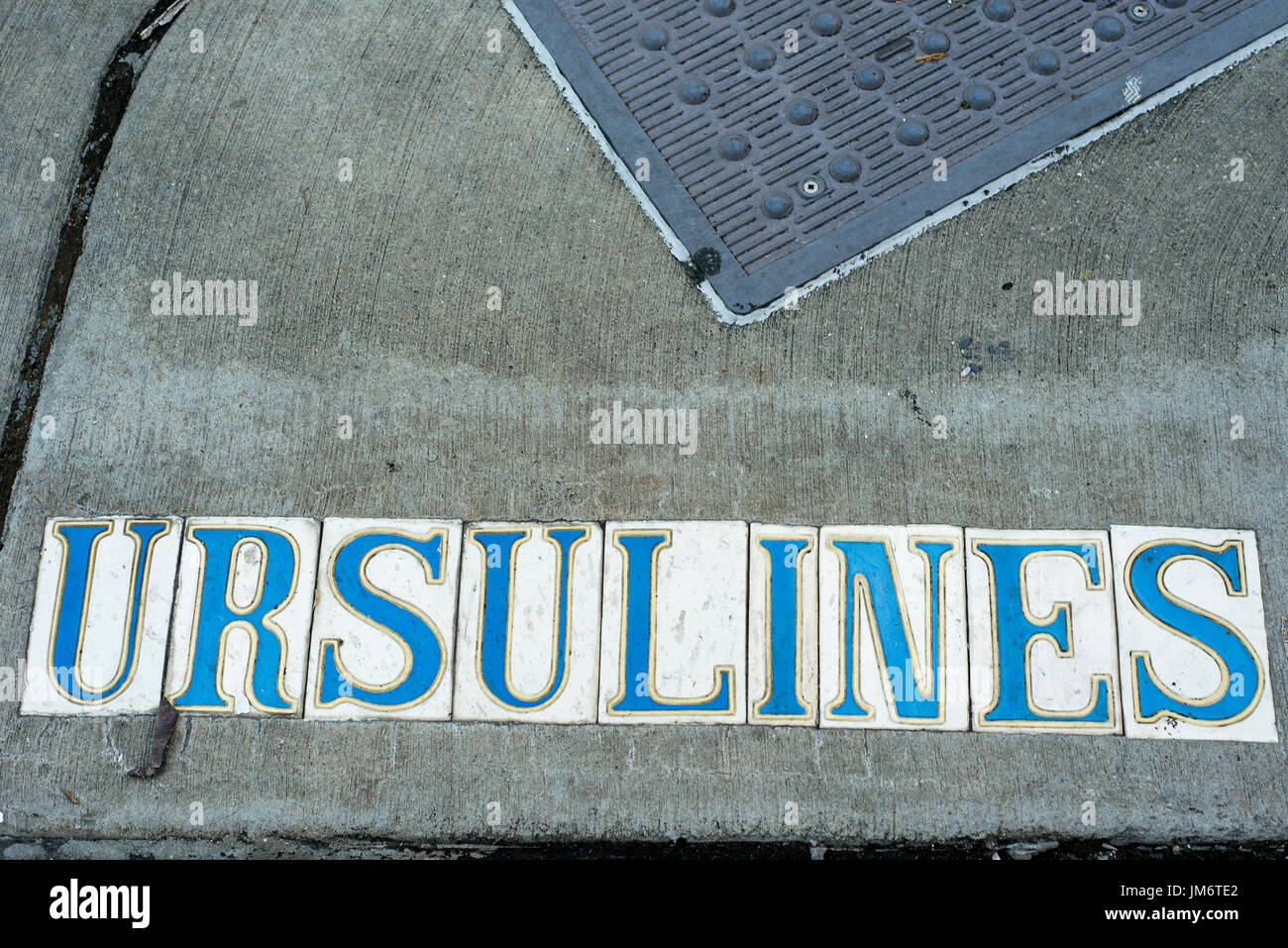 Ursulines lettered ceramic tiles spelling out the street name New Orleans - Stock Image
