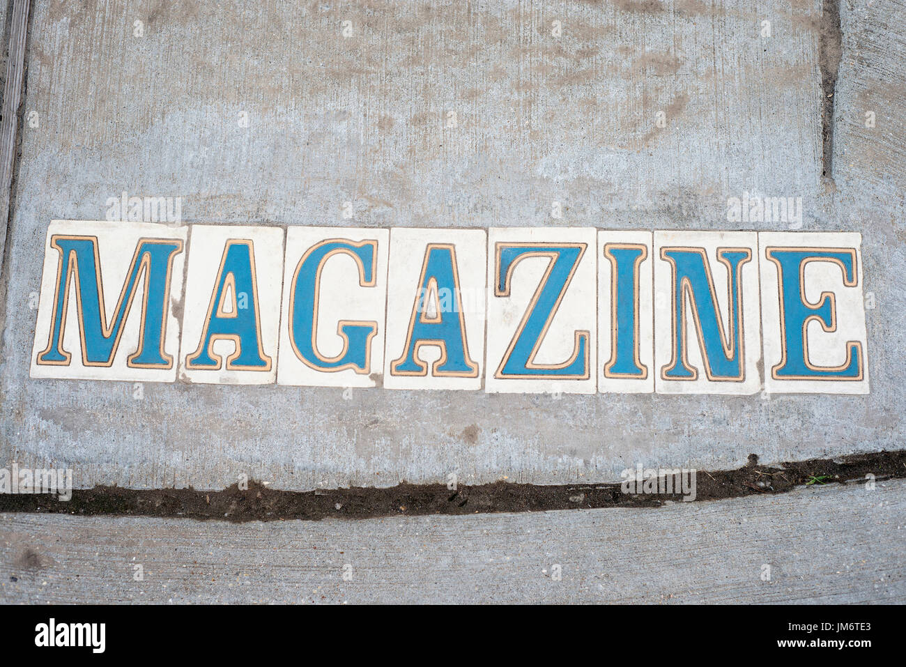 Tile letters spelling out Magazine used as street signs in New Orlean, Louisiana. - Stock Image
