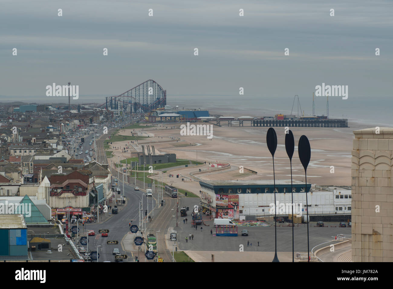 An aerial image of Blackpool's golden mile. With the Pleasure Beaches - Big One roller coaster in the distance. credit: LEE RAMSDEN / ALAMY - Stock Image
