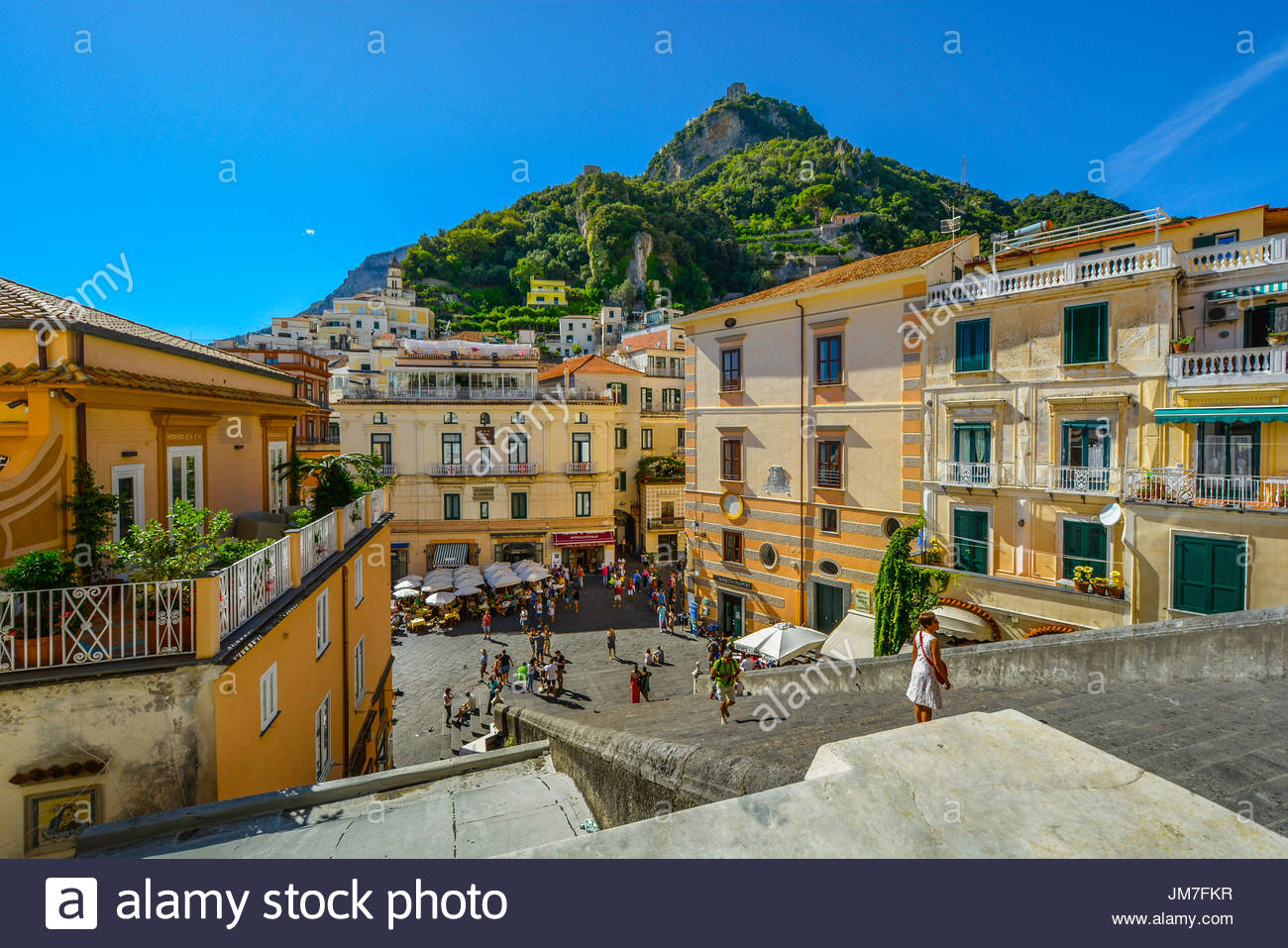 Mountain and city from the top of the stairs of the Amalfi Cathedral on the Amalfi Coast of Italy on a warm and clear summer day - Stock Image