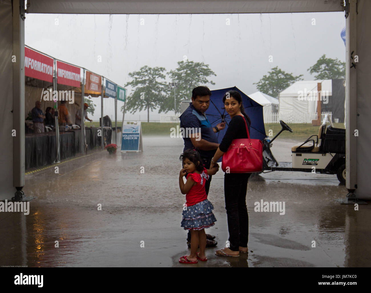 Family getting ready to go out in the rain. - Stock Image