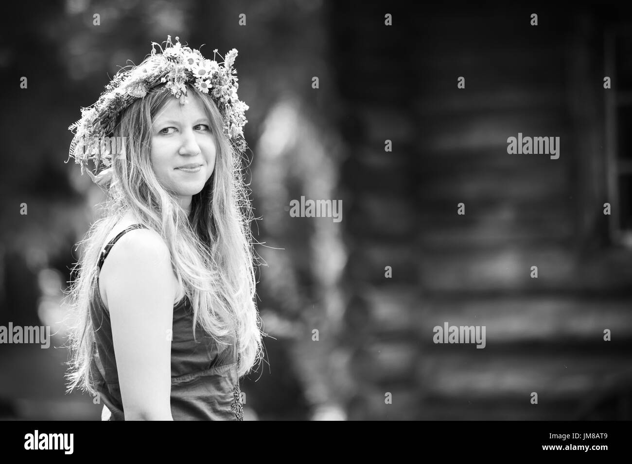 young blond adult woman with wreath on her head, black and white - Stock Image