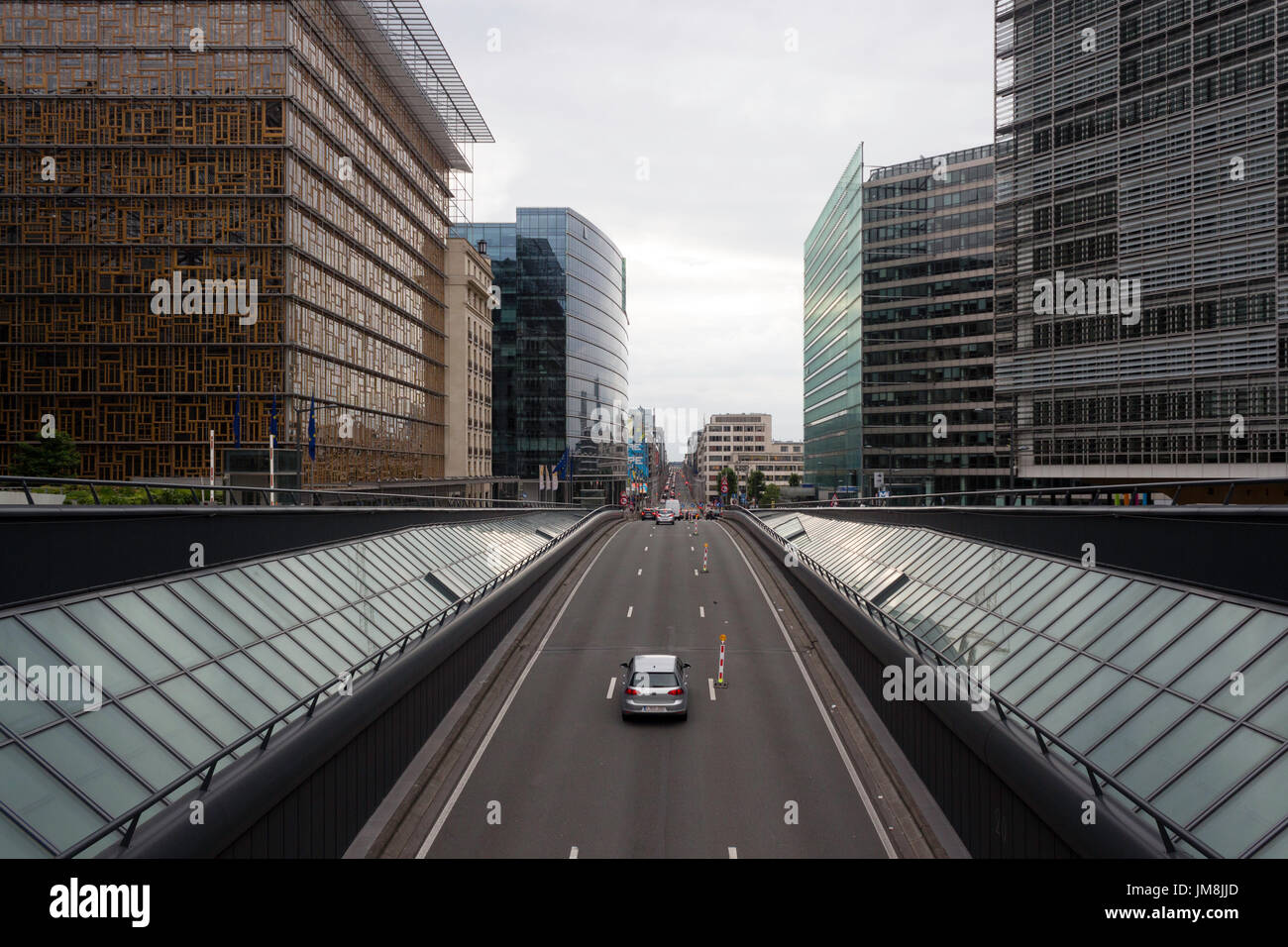Cars coming out of a tunnel in Brussels, Rue de la Loi close to Shuman, next to the European Council and the Headquarters of European Union. - Stock Image