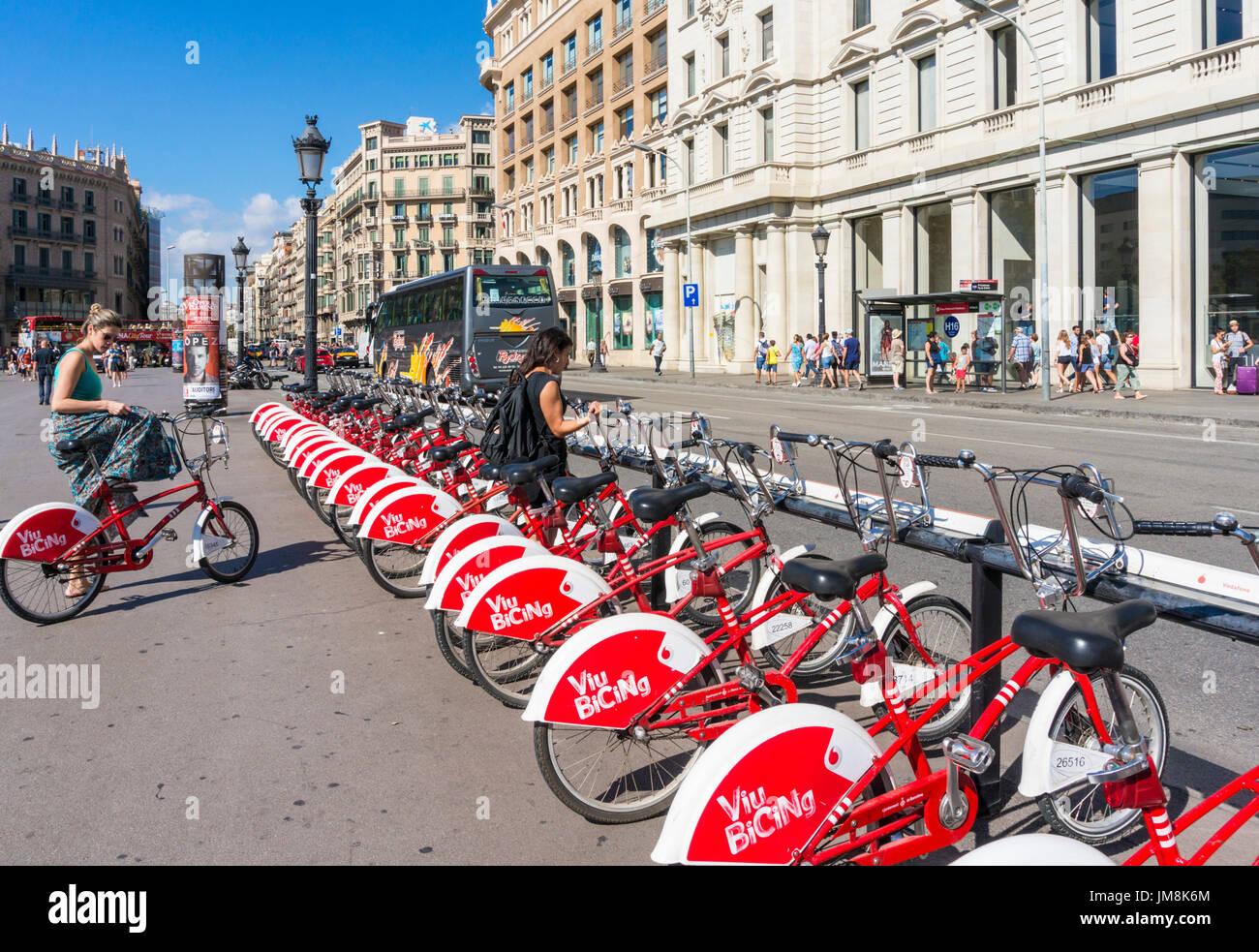 Barcelona Spain Catalunya barcelona Plaça de Catalunya Santander bikes cycle hire woman on bike central square of Barcelona spain eu europe Catalonia - Stock Image