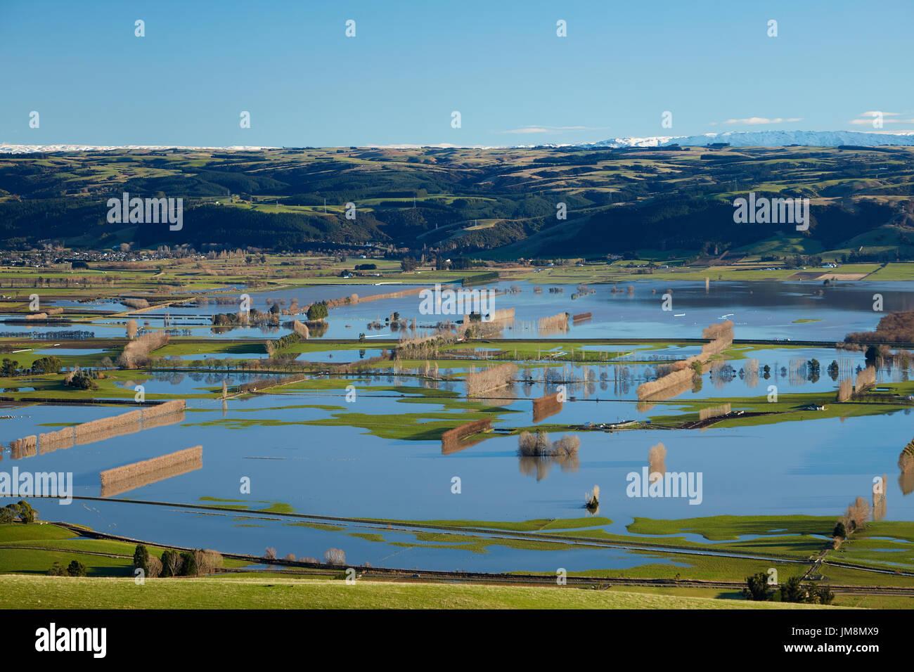 Flooded farmland on Taieri Plains, near Mosgiel, Dunedin, South Island, New Zealand Stock Photo