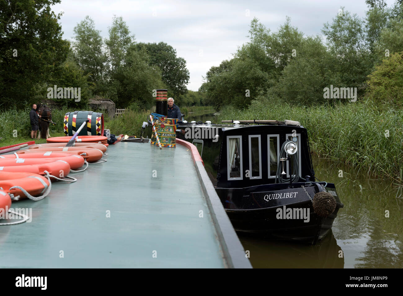 Narrowboats manoeuvre on a narrow stretch of the Kennet & Avon Canal in Berkshire England UK - Stock Image