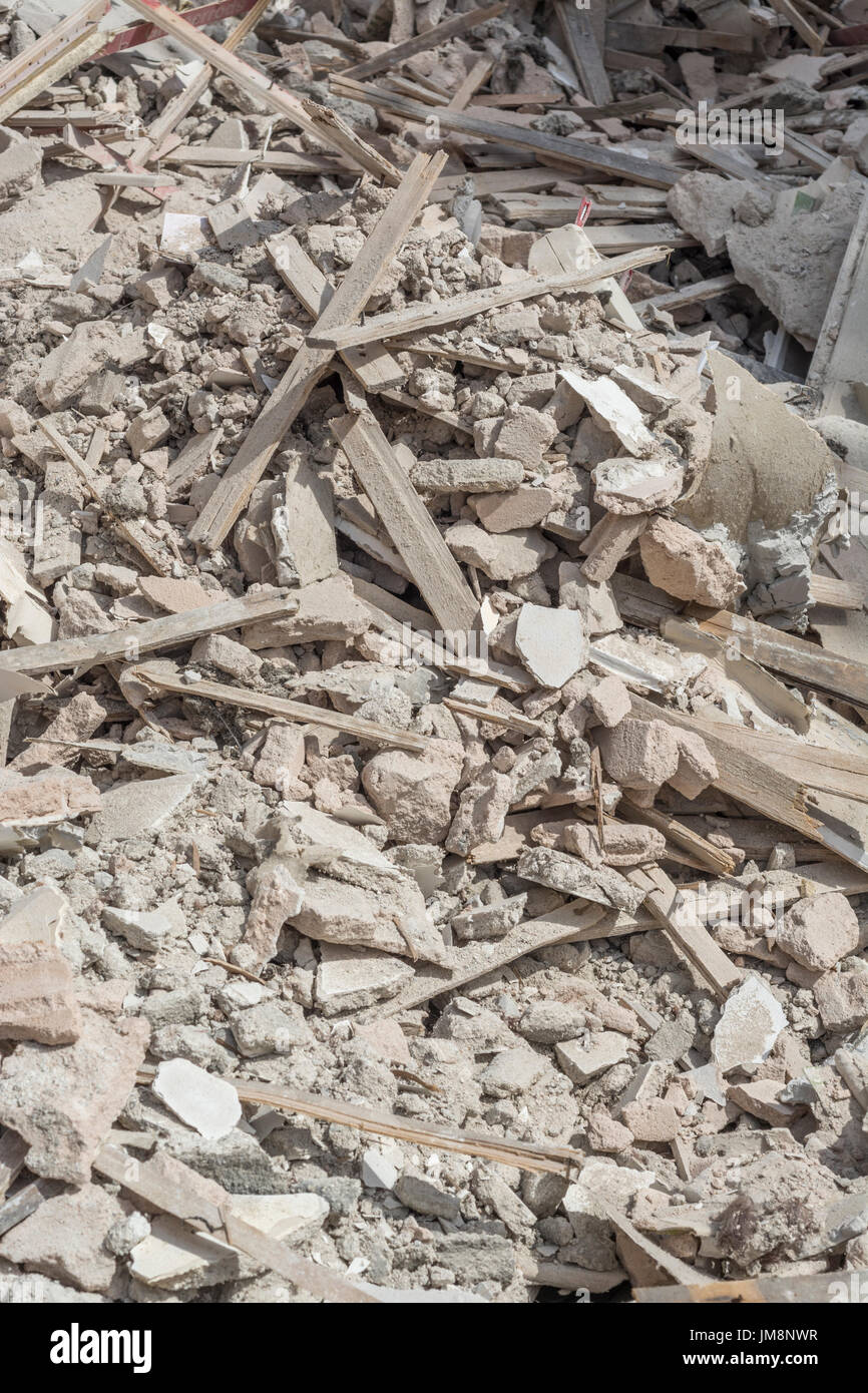 Builder's rubble - specifically old lime-based 'lath and plaster' ceiling debris from old cottage. Metaphor broken in pieces, in tatters, shattered. - Stock Image