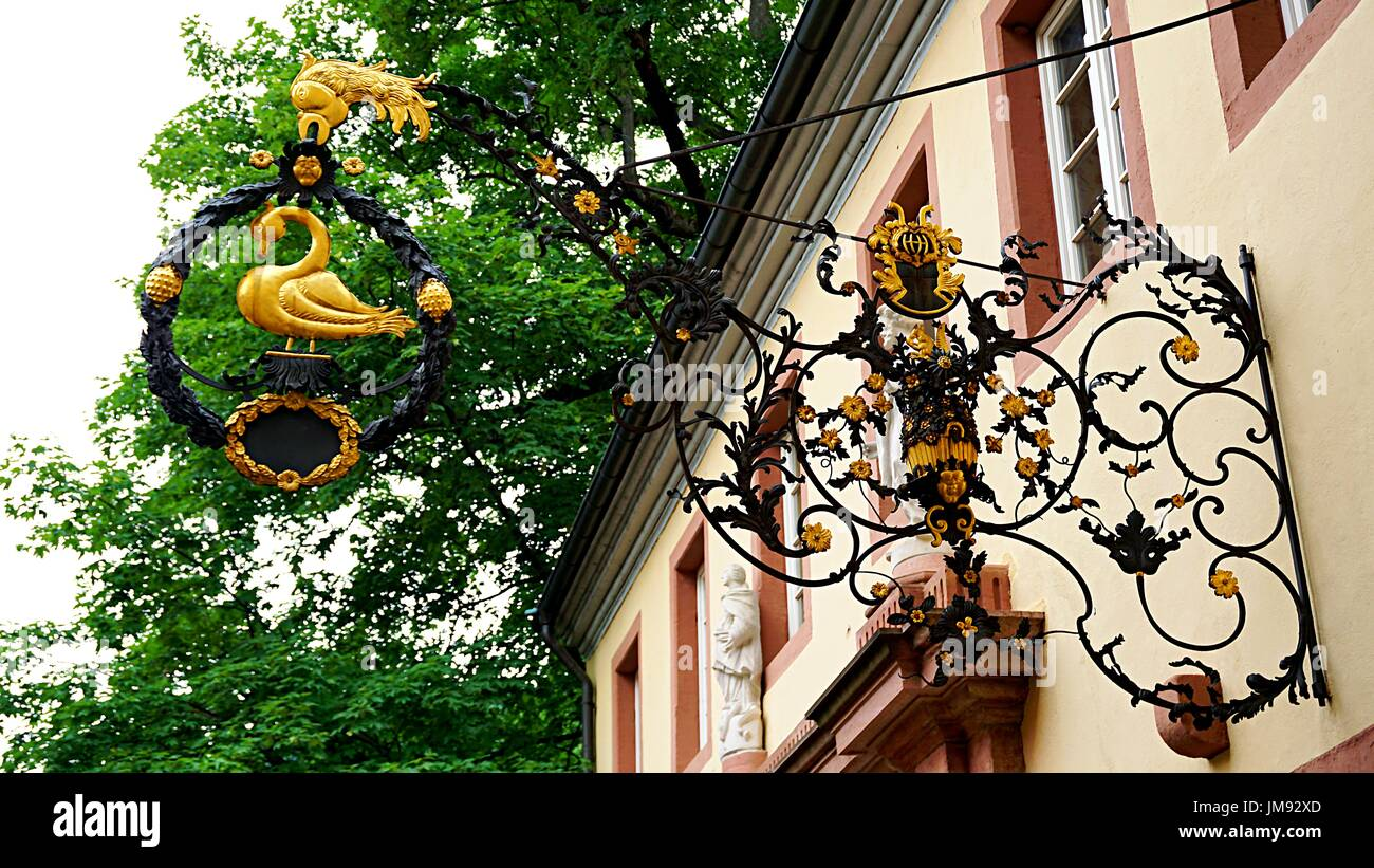 Alloy swan duck crafting for decoration in front of building in old town Heidelberg, Germany - Stock Image