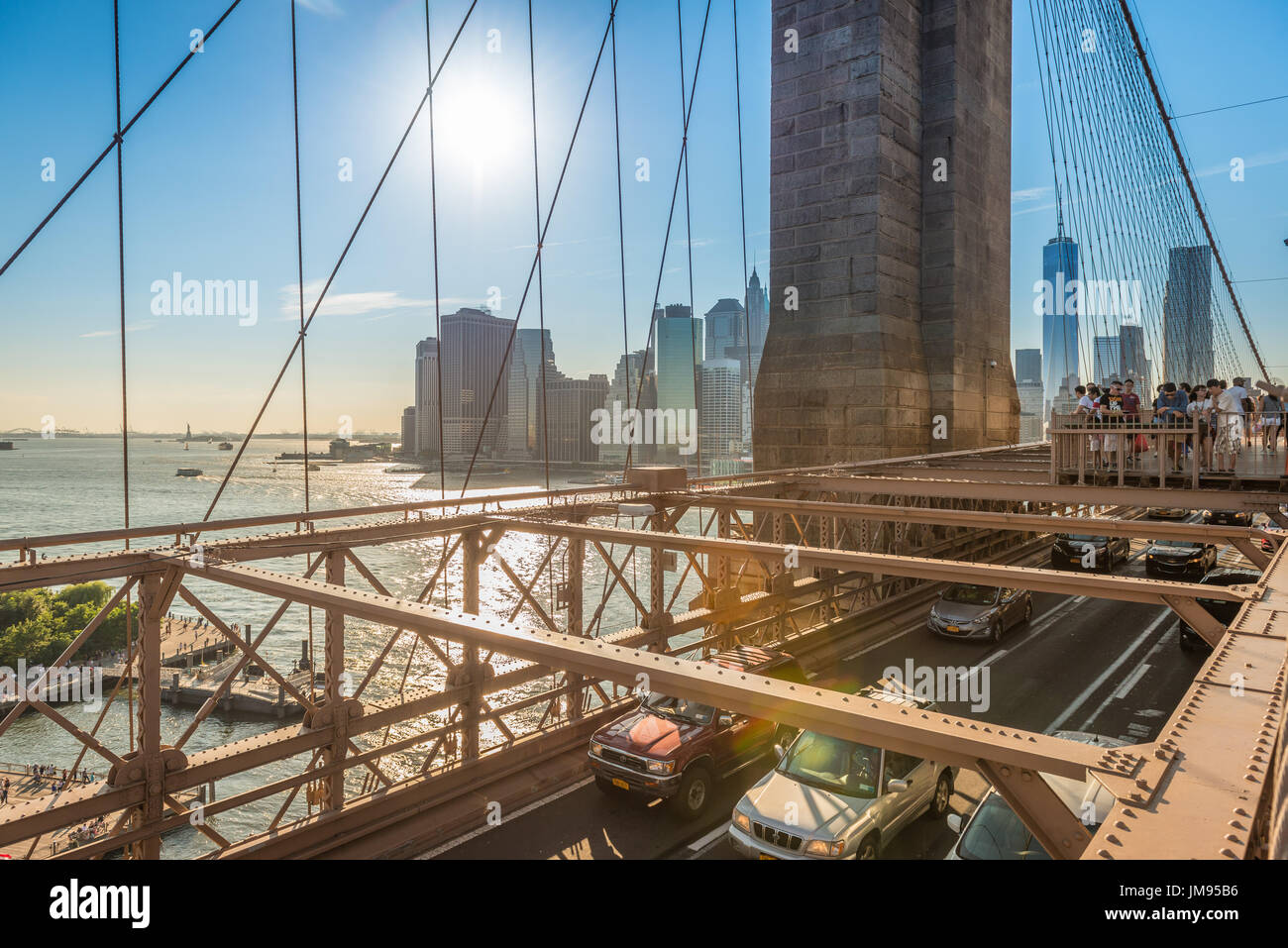 Views of Lower Manhattan and New York from the Brooklyn Bridge during summertime, New York, USA - Stock Image