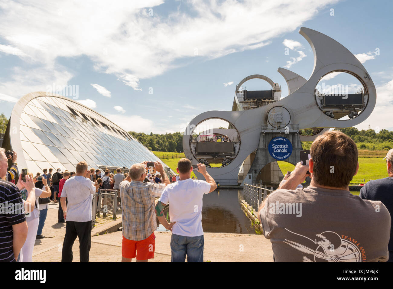 The Falkirk Wheel - people taking photographs of Falkirk Wheel turning rotating, Scotland - Stock Image