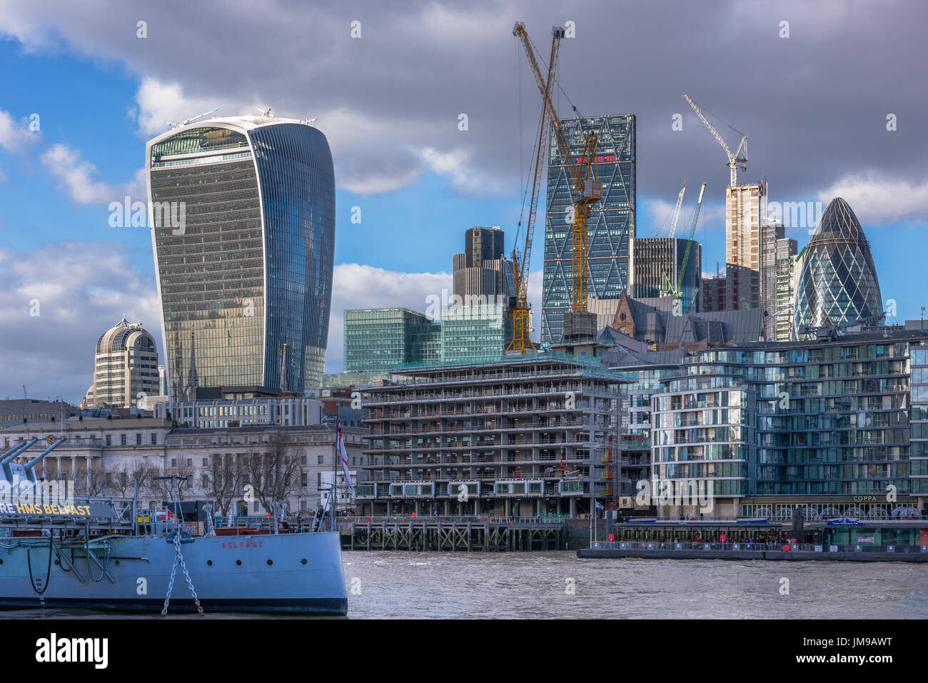 Tower cranes dominate the skyline as development in the heart of the city of London moves on at a pace. - Stock Image