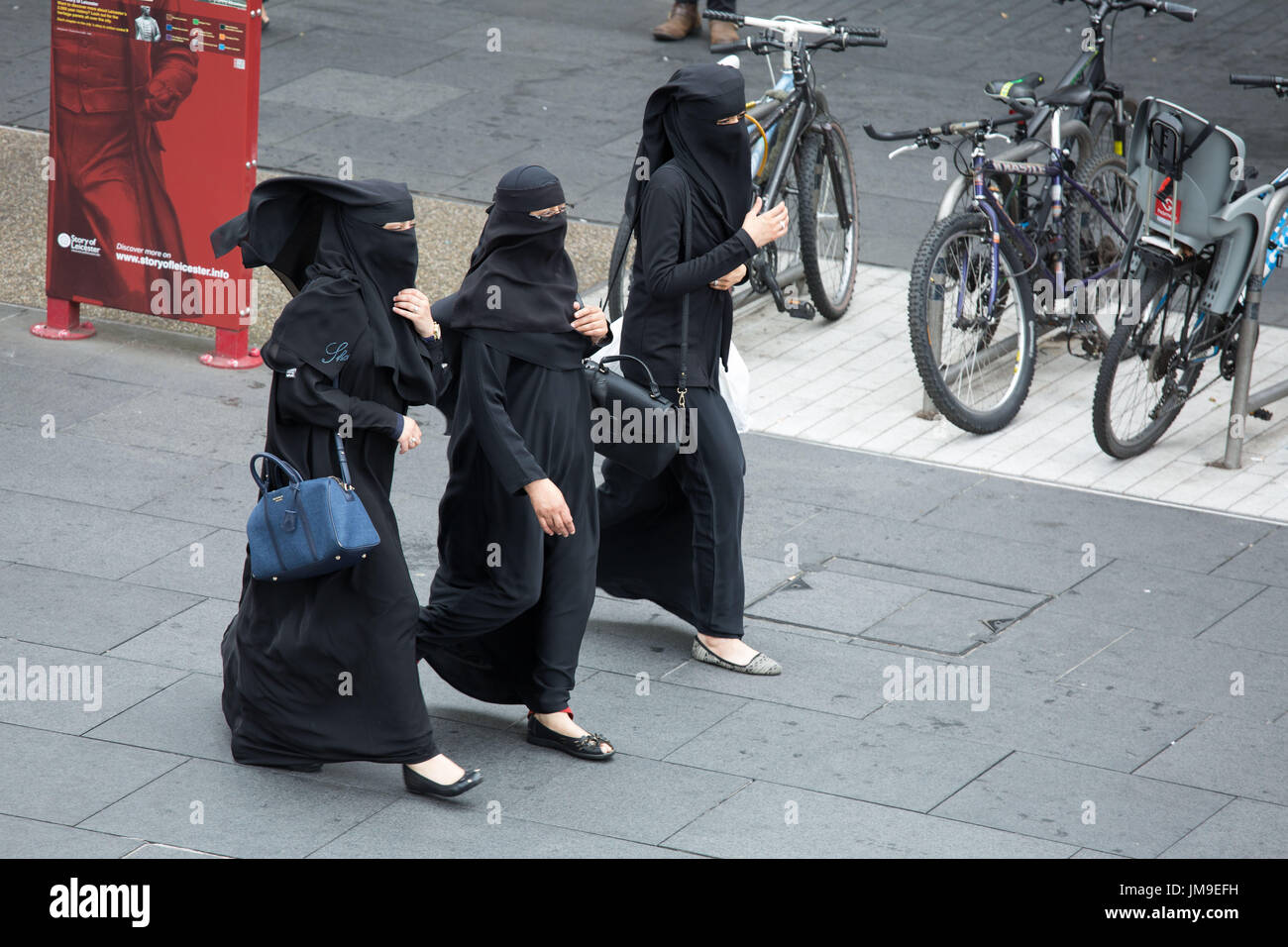 Three women wearing the traditional Niqab pictured in the centre of Leicester - Stock Image