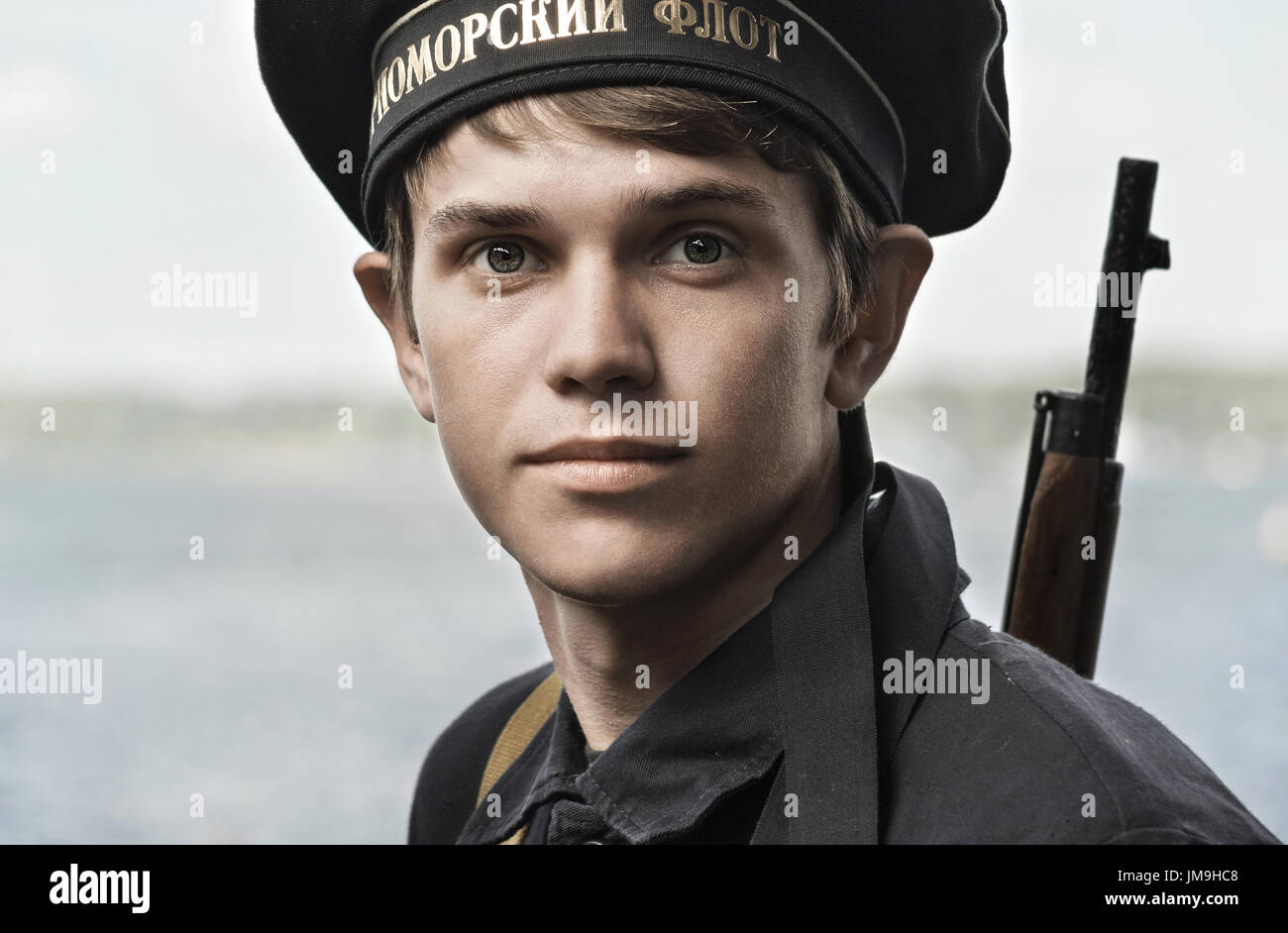 Historical festival of the Second World war in Samara , July 26, 2015. Portrait of a cabin boy on the background of the Volga river. - Stock Image