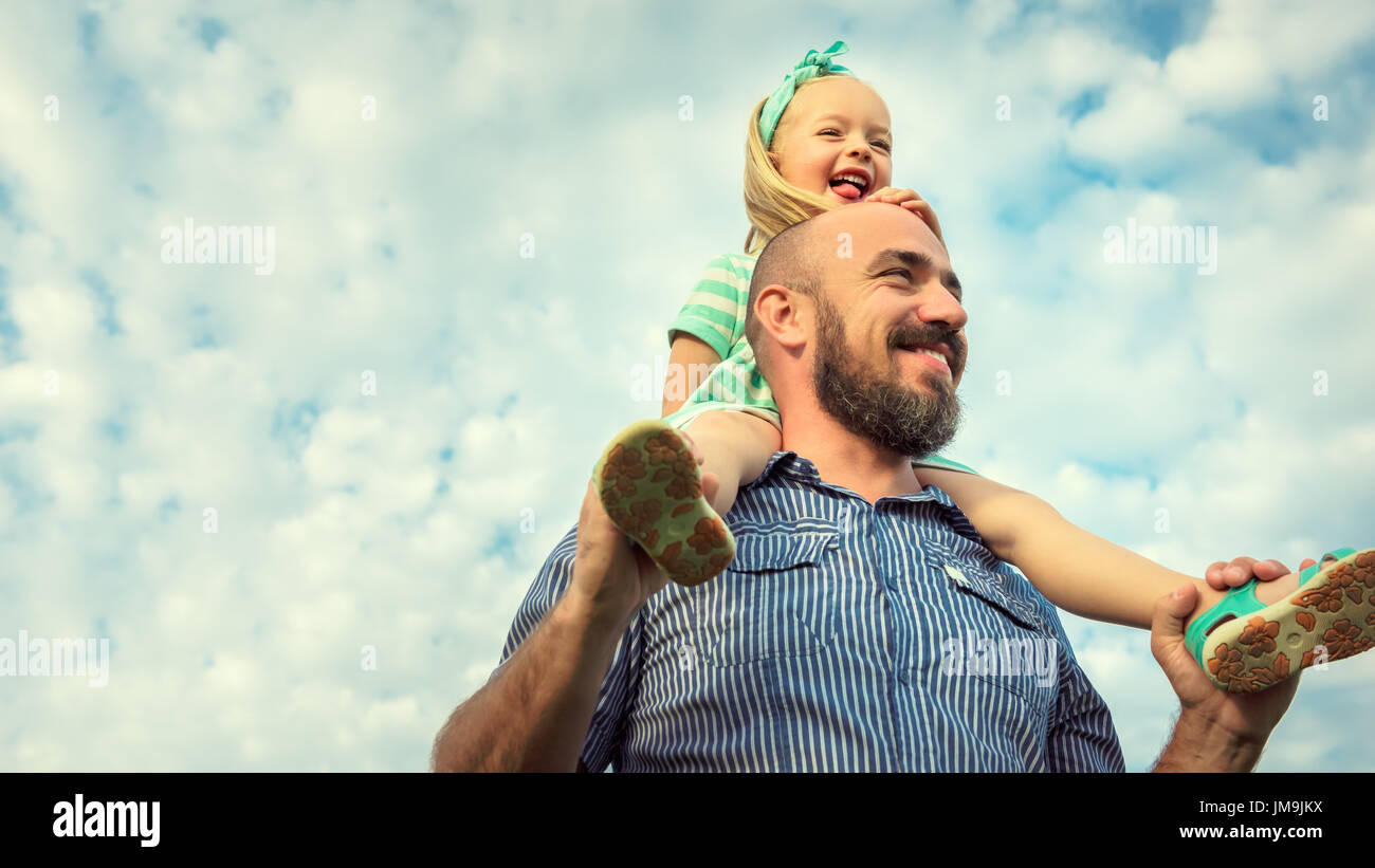 Adorable daughter and father portrait, happy family, future concept - Stock Image