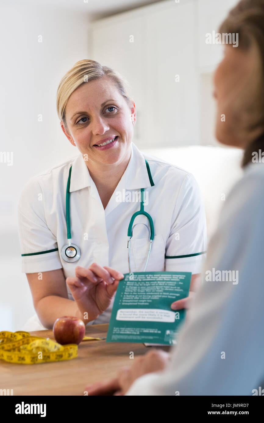 Mature Woman Meeting With Dietician In Doctors Office - Stock Image
