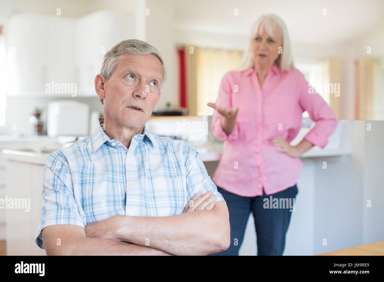 Senior Couple Having Argument At Home - Stock Image