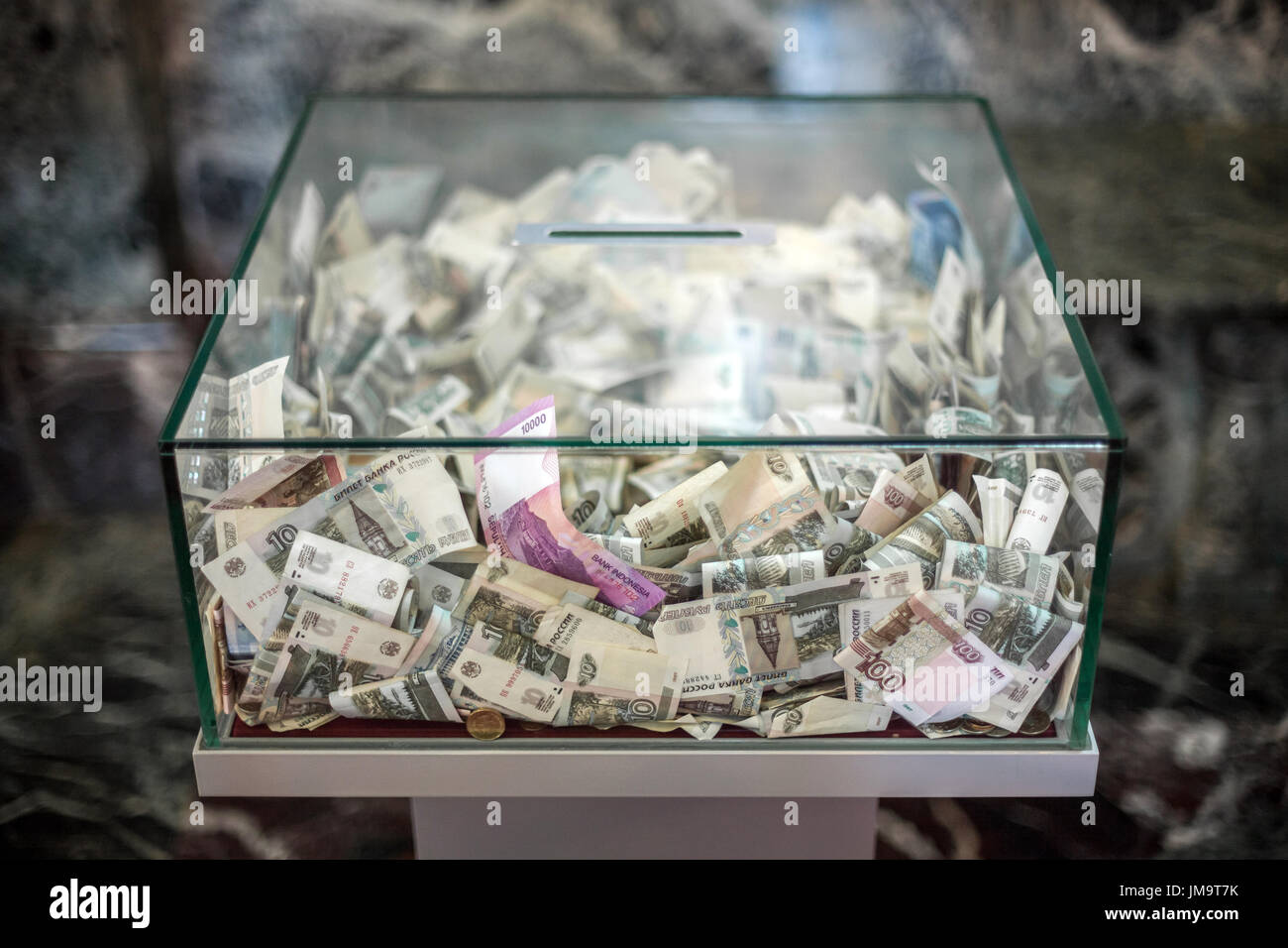 Rubles in a church donation box. Moscow, Russian Federation. - Stock Image