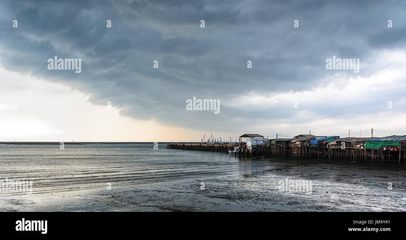 The clound and sea shot at a port, Ang Sila fish market, Thailand. - Stock Image