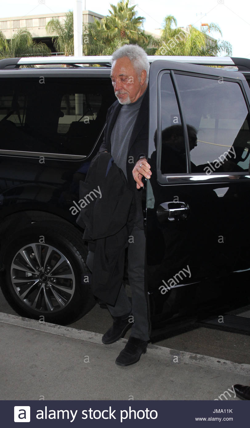 sir tom jones gets out of a chauffeur driven limo as he gets ready to board a flight out of los angeles the legendary welsh singer was seen at