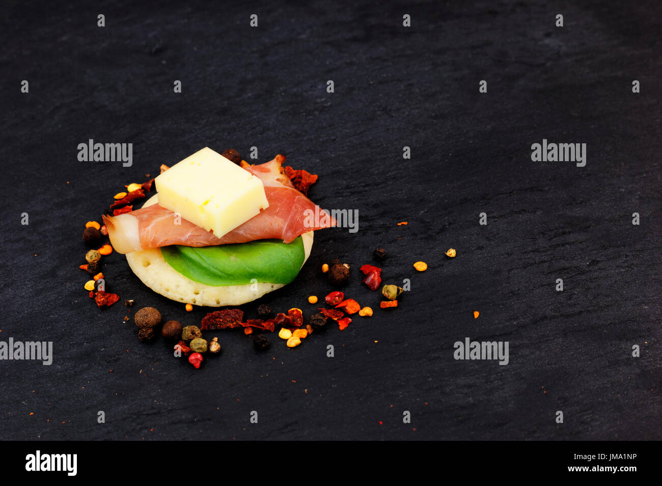 Homemade pancake canapes on slate stone plate for finger food party - Stock Image