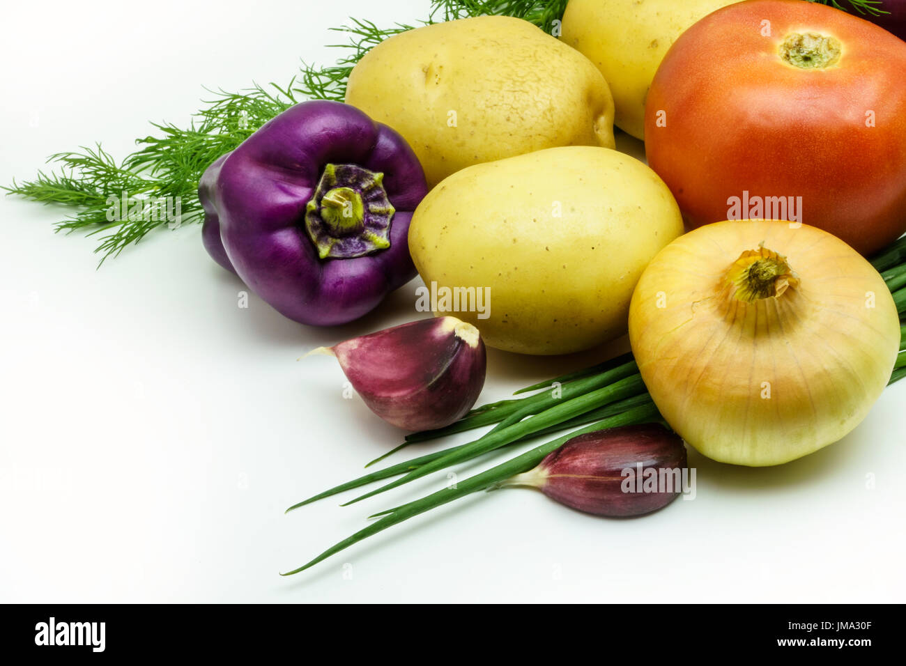 Assortment of fresh raw vegetables isolated on white background. Selection includes potato, tomato, green onion, Stock Photo