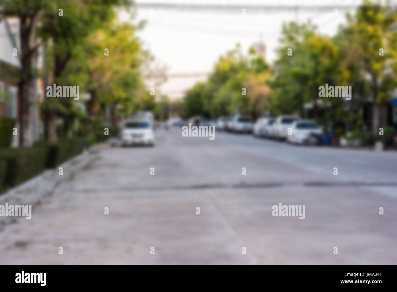 Blur image of road and house in the village for background usage with copy space. - Stock Image