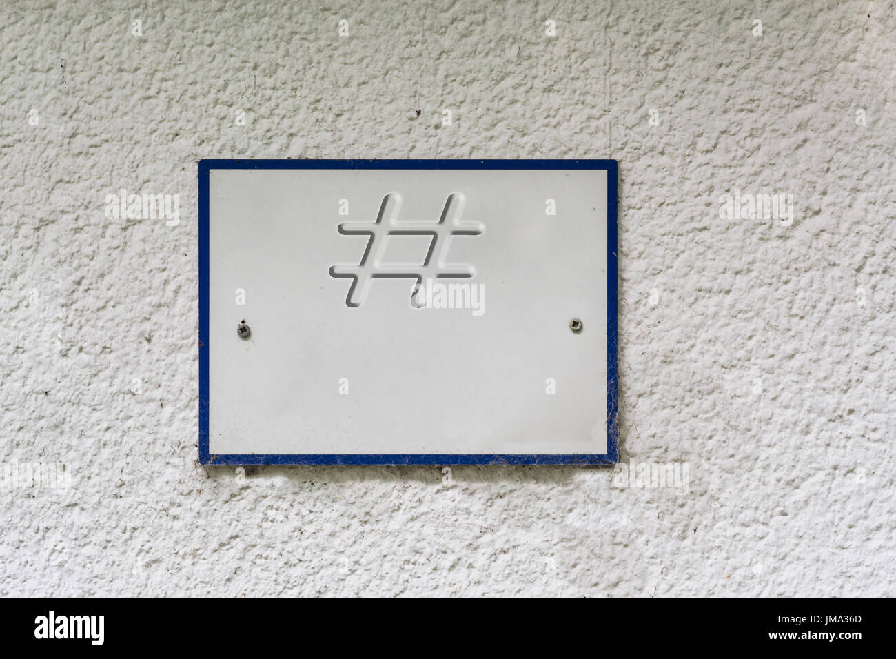Information sign or board on a house wall with lettering # - Stock Image