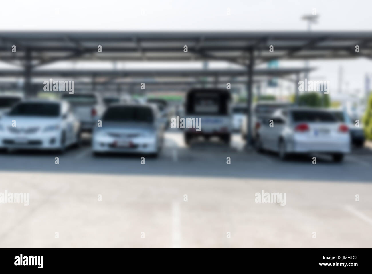 blur image of car park in outdoor parking with copy space for background usage - Stock Image