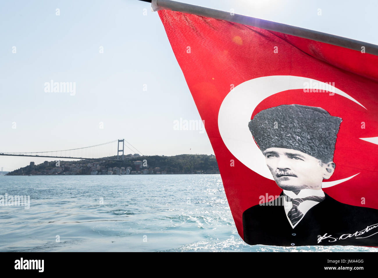 View of Bosphorus ,coast and sea bay from the ferry with Turkish flag on the picture of Ataturk(Father of Turks)waving in the wind, Beykoz in Istanbul - Stock Image