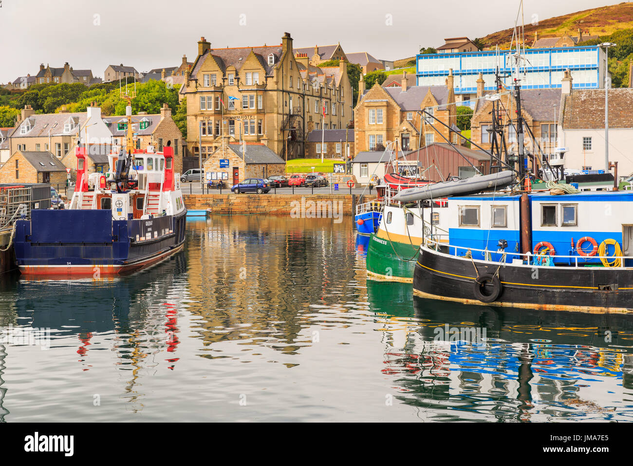 Fishing boats moored in the harbour. Stromness, Orkney, Scotland. - Stock Image