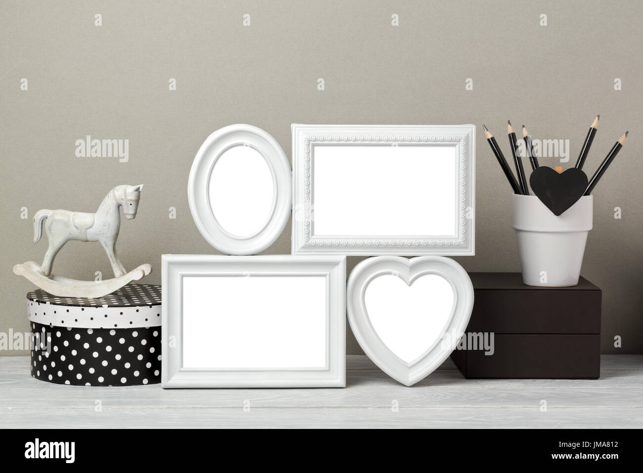 Frames mock up with rocking horse toy and pencils. Nursery or kids room interior background - Stock Image
