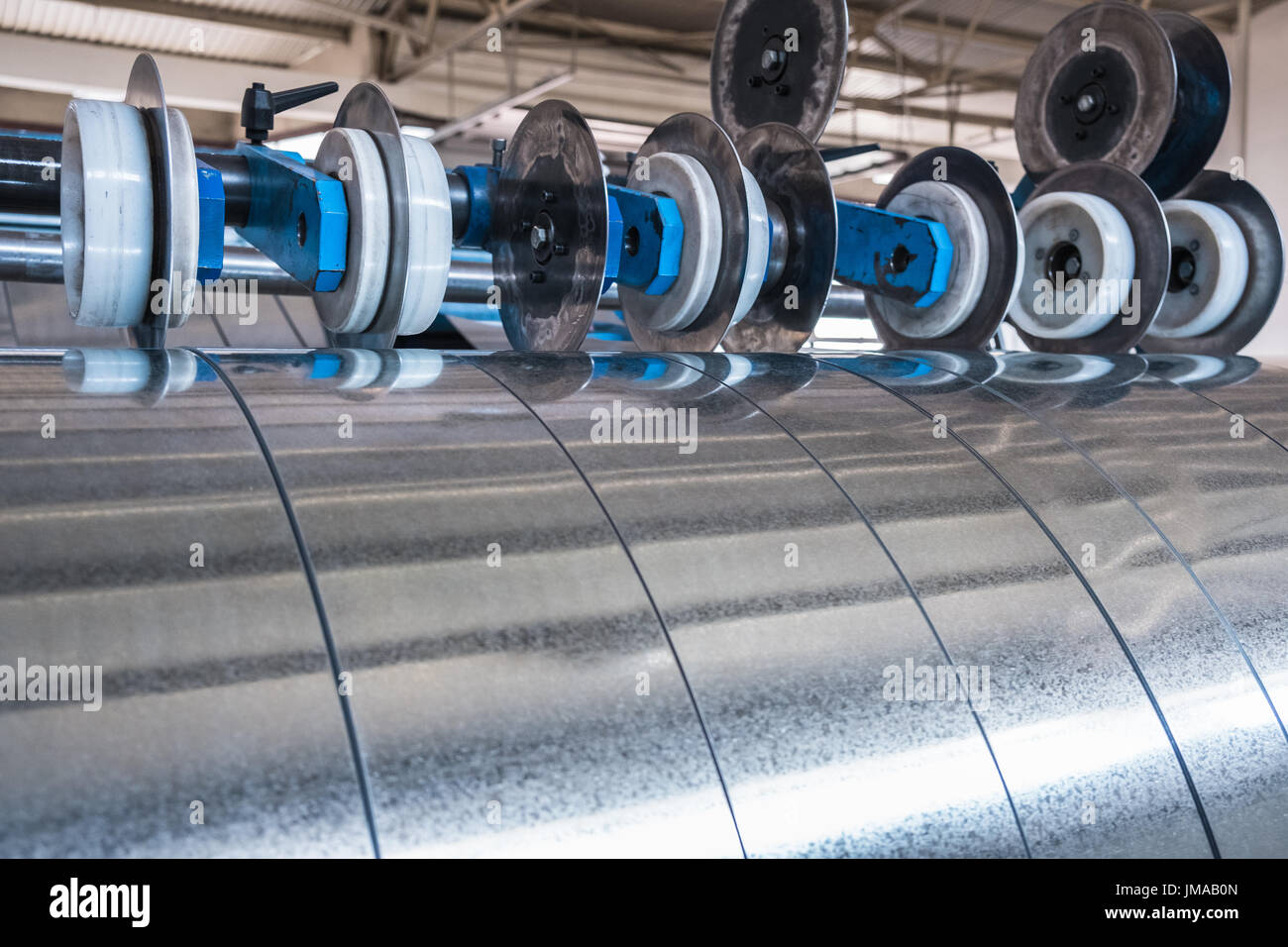 Galvanized steel strips processed on the slitting line Stock Photo