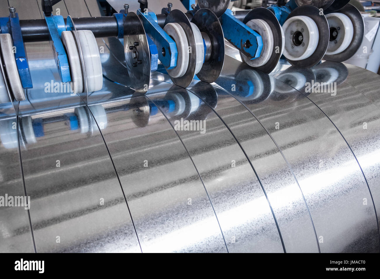 Galvanized steel strips processed on the slitting line - Stock Image