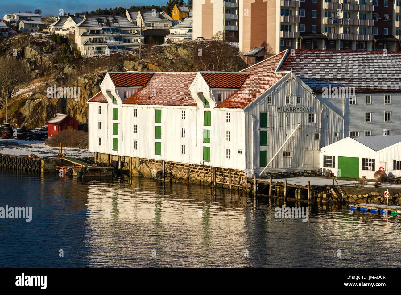 Dockside wooden warehouses on the island of Kirkelandet, the harbour district of Kristiansund, Møre og Romsdal, Norway. - Stock Image