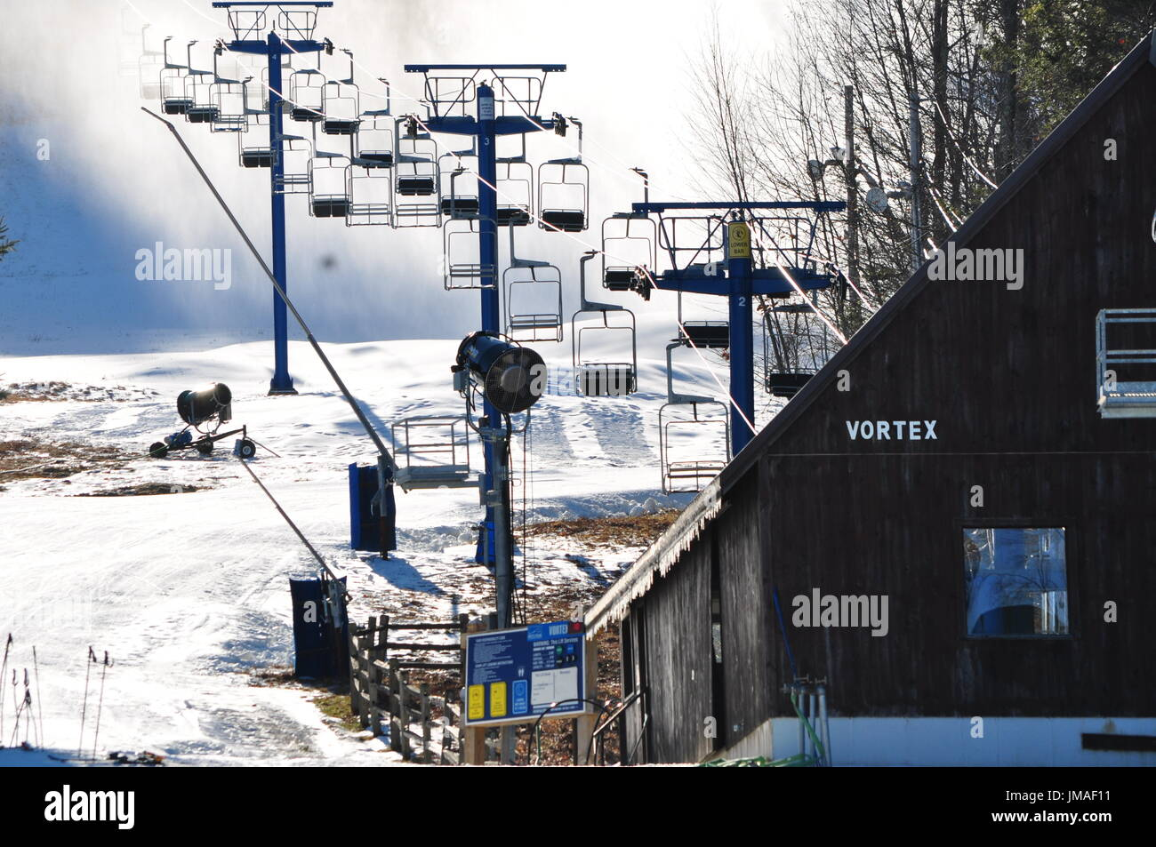 Skilift and snowmaking in Pat's Peak Stock Photo
