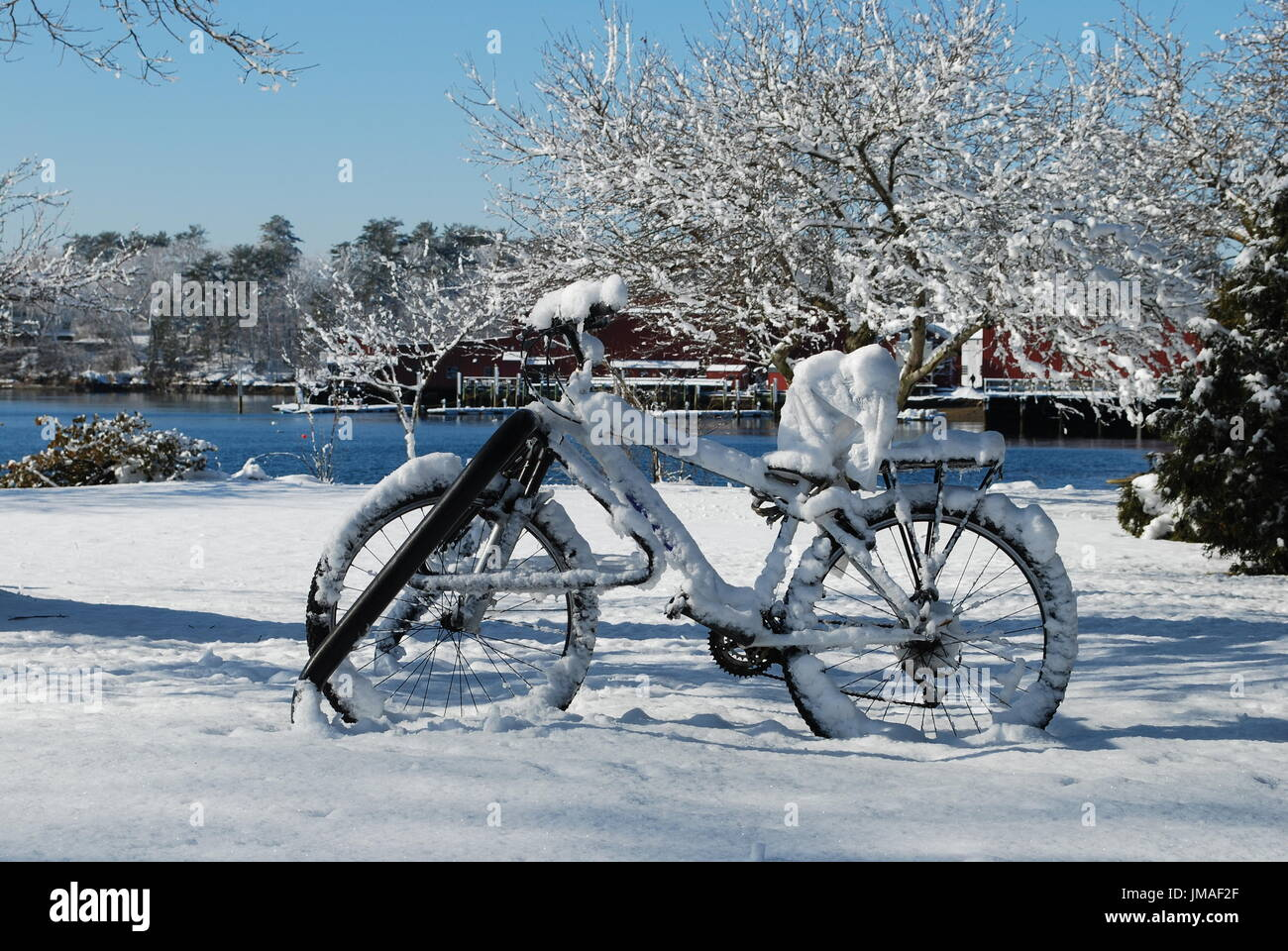 Snow covered bicycle - Stock Image