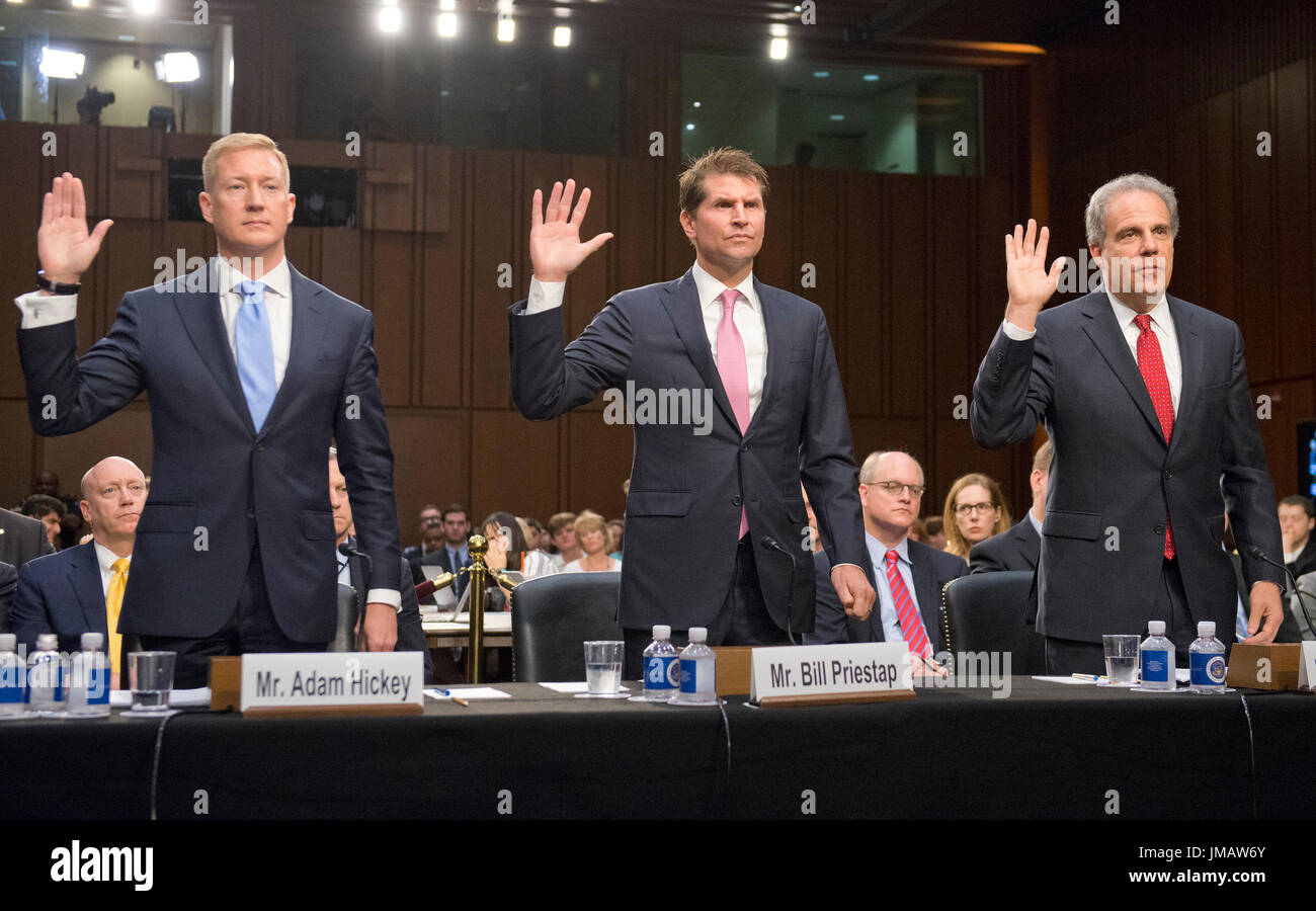 From left to right: Adam Hickey, Deputy Assistant Attorney General, National Security Division, United States Department Of Justice; E.W. 'Bill' Priestap, Assistant Director, Counterintelligence Division, Federal Bureau Of Investigation (FBI); and Michael Horowitz, Inspector General, US Department Of Justice, are sworn-in to testify before the US Senate Committee on the Judiciary oversight hearing to examine the Foreign Agents Registration Act (FARA) and attempts to influence US elections, focusing on lessons learned from current and prior administrations on Capitol Hill in Washington, DC on W - Stock Image