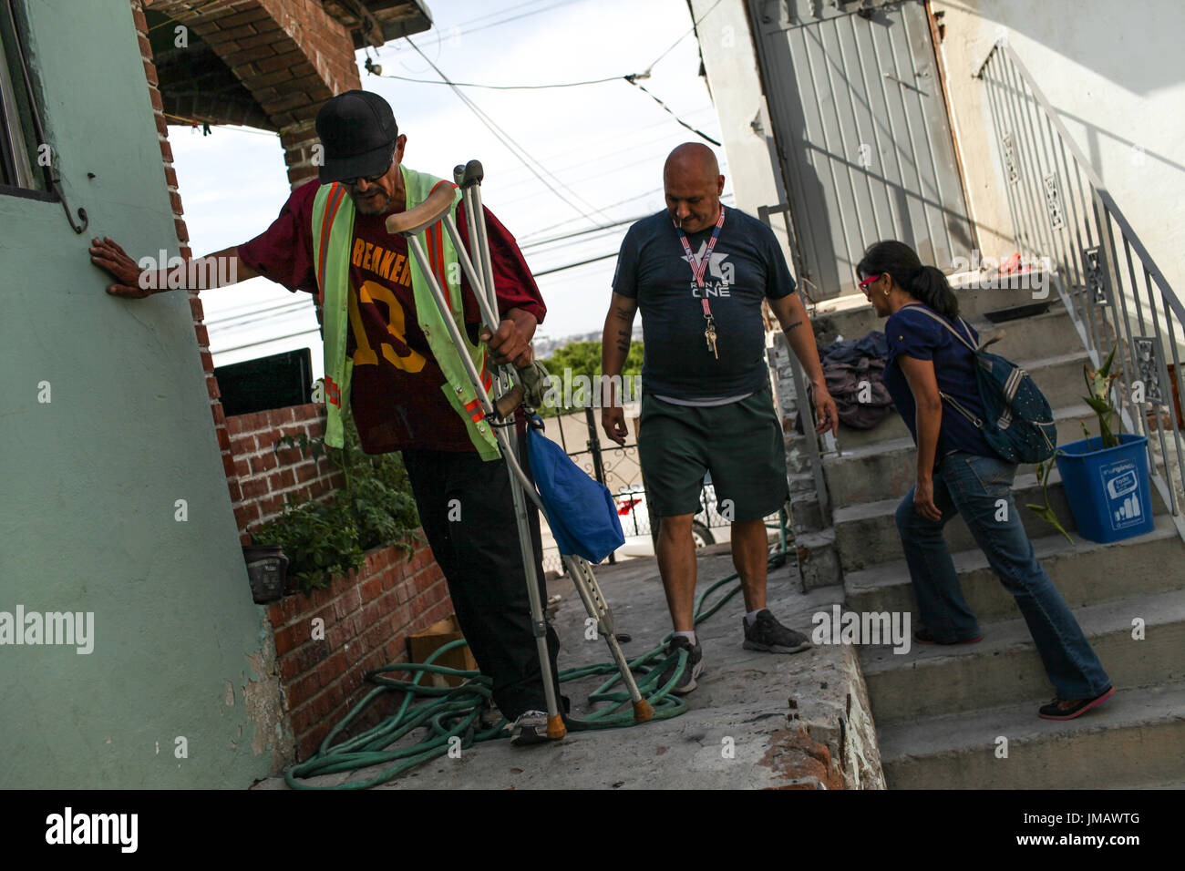 Tijuana, Baja California, Mexico. 7th July, 2017. Deported U.S. Army veteran ARMANDO CERVANTES (L) guides deported U.S. Army veteran HECTOR BARAJAS-VARELA (C) and deported mother YOLANDA VARONA (R) to his shack in Tijuana, Baja California, Mexico. Barajas-Varela is working with Cervantes to construct him a new home. Credit: Joel Angel Juarez/ZUMA Wire/Alamy Live News - Stock Image
