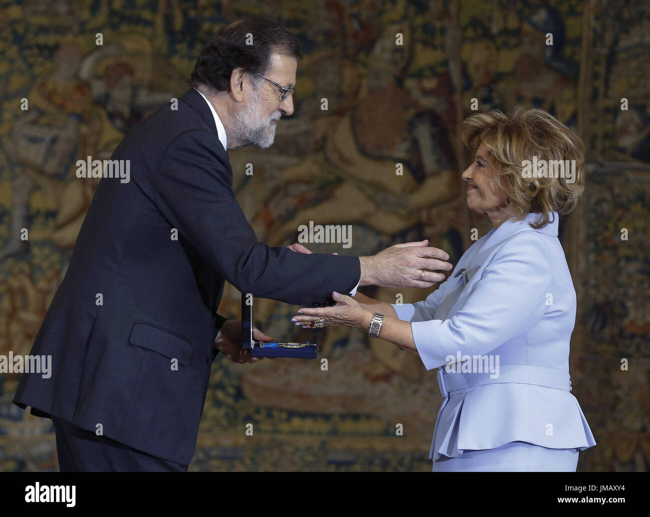 Madrid, Spain. 27th July, 2017. Spanish Prime Minister, Mariano Rajoy (L), grants the Gold Medal of Merit in Work to Spanish journalist Teresa Campos during the Gold Medal of Merit in Work handover ceremony held at the Palace of la Moncloa in Madrid, Spain, 27 July 2017. EFE/Paco Campos Credit: EFE News Agency/Alamy Live News - Stock Image
