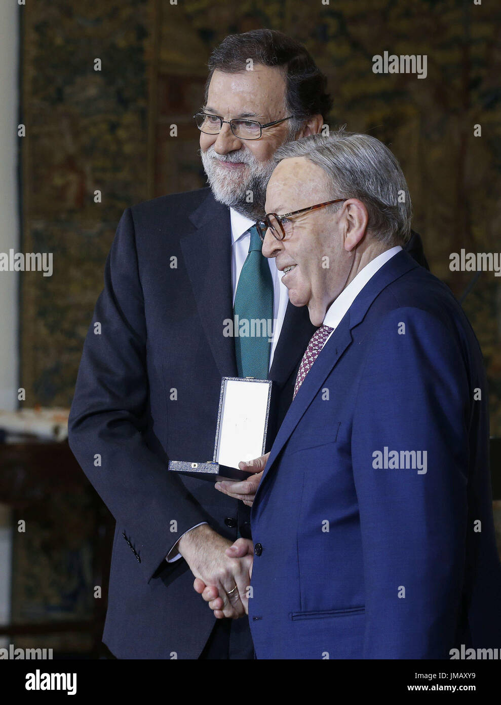 Madrid, Spain. 27th July, 2017. Spanish Prime Minister, Mariano Rajoy (L), grants the Gold Medal of Merit in Work to Spanish saxophonist Pedro Iturralde during the Gold Medal of Merit in Work handover ceremony held at the Palace of la Moncloa in Madrid, Spain, 27 July 2017. EFE/Paco Campos Credit: EFE News Agency/Alamy Live News - Stock Image