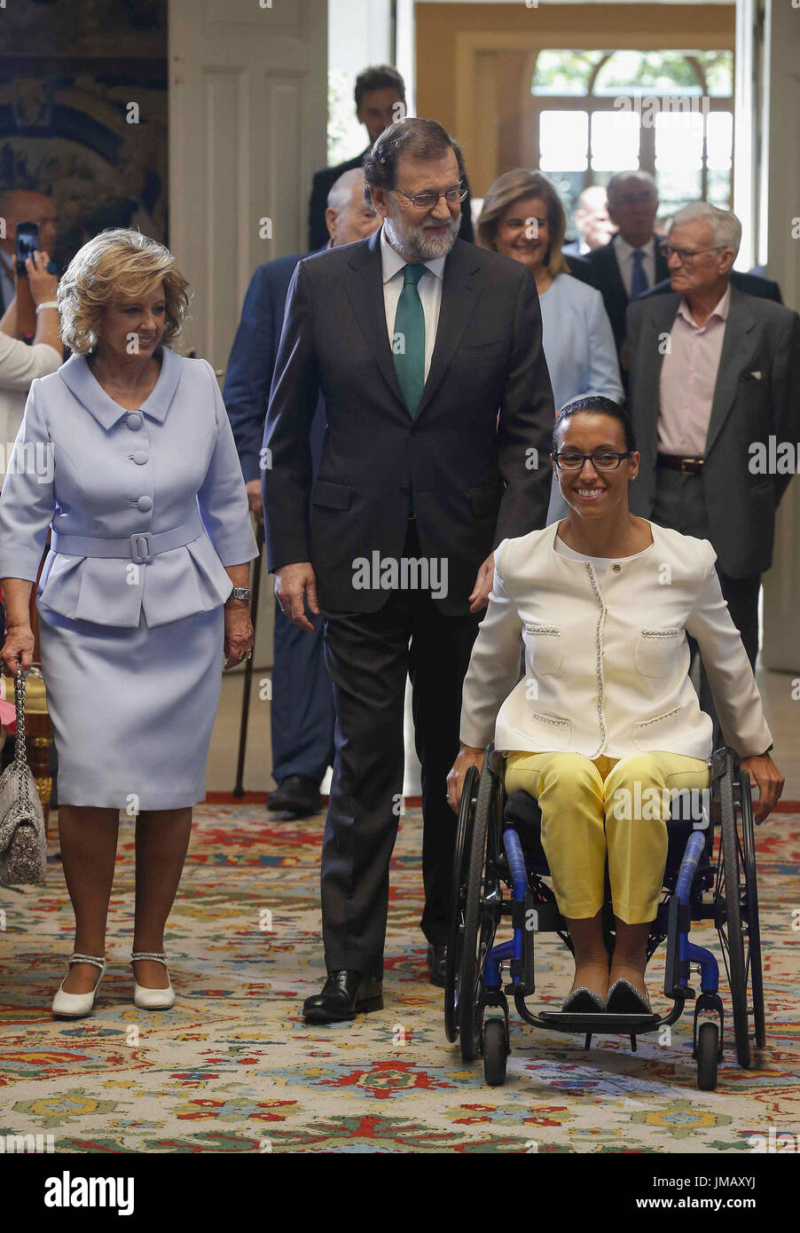 Madrid, Spain. 27th July, 2017. Spanish Prime Minister, Mariano Rajoy (C), greets laureates Spanish journalist Teresa Campos (L) and paralympic swimmer Teresa Perales prior to the start of the Gold Medal of Merit in Work handover ceremony held at the Palace of la Moncloa in Madrid, Spain, 27 July 2017. EFE/Paco Campos Credit: EFE News Agency/Alamy Live News - Stock Image