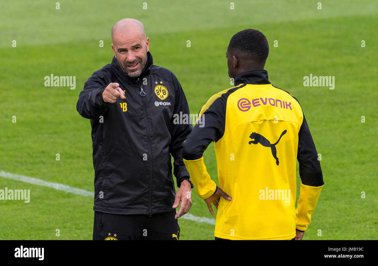 Bad Ragaz, Switzerland. 27th July, 2017. Dortmund coach Peter Bosz (l) gives instructions to Dortmund's Ousmane Dembele at the training camp of German Bundesliga club Borussia Dortmund in Bad Ragaz, Switzerland, 27 July 2017. Photo: Guido Kirchner/dpa/Alamy Live News - Stock Image
