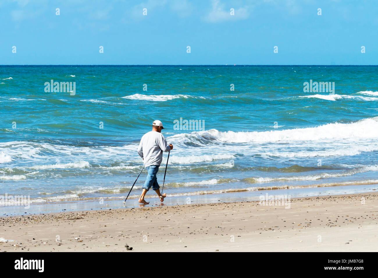 Nordic walking on the beach - Stock Image