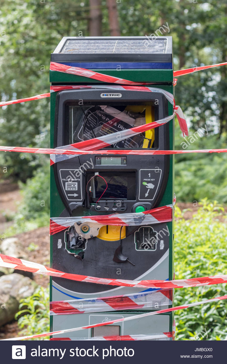 A solar powered car park ticket machine in a rural location, destroyed by vandalism. - Stock Image